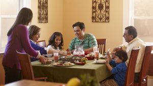 multigenerational family eating around a table