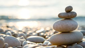 balanced stack of stones on beach