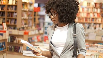 young woman in bookstore