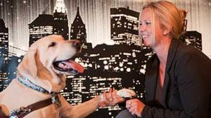 woman smiling at dog