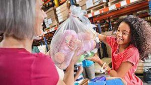 child donating stuffed animals
