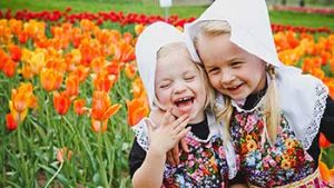 young girls playing in flowers