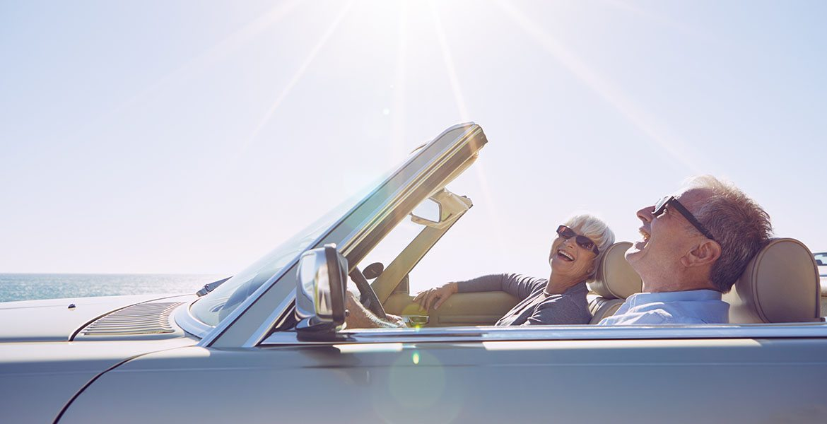 retired couple in convertible