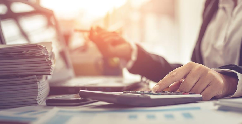 investor at desk considering dollar cost averaging