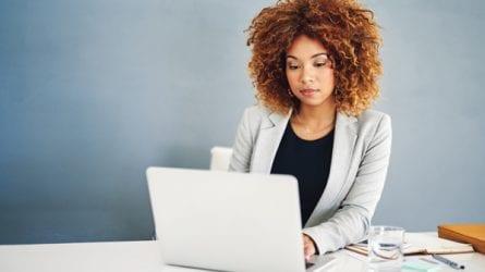 female investor working on laptop