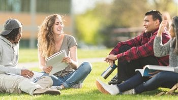 Image depicts high school students laughing and studying as they prepare for college.