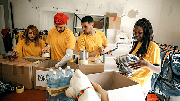 Volunteers sort blankets and other disaster relief supplies.