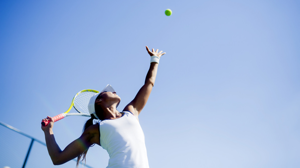 A woman is playing tennis.