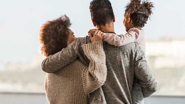 Family members embrace each other.