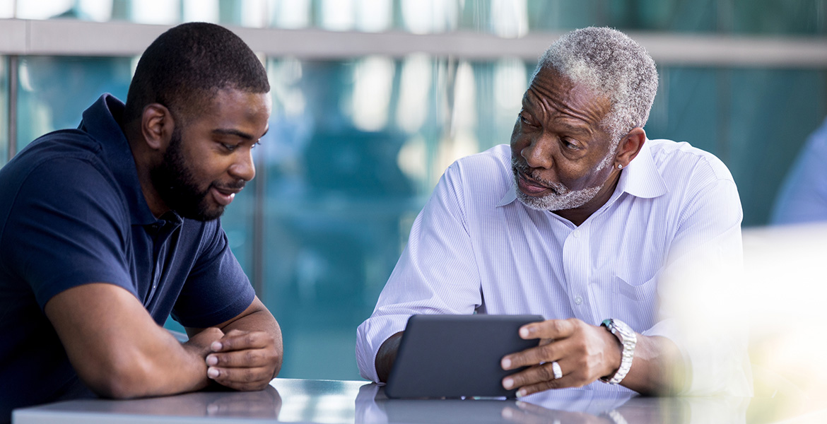 A man and his father have a conversation.