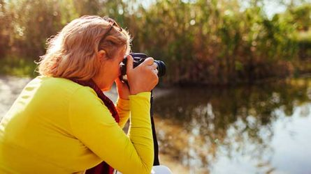 A woman takes pictures outdoors.
